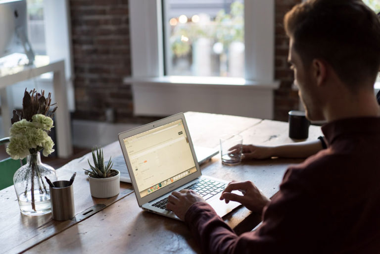How to Start an LLC - Man working in office on his business